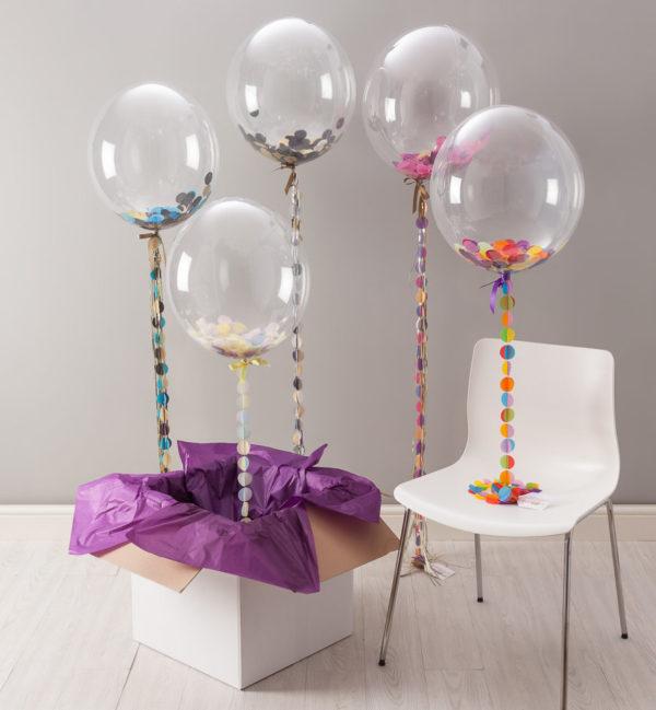 Шар bubbles с перьями заправленный гелием в студии Город друзей